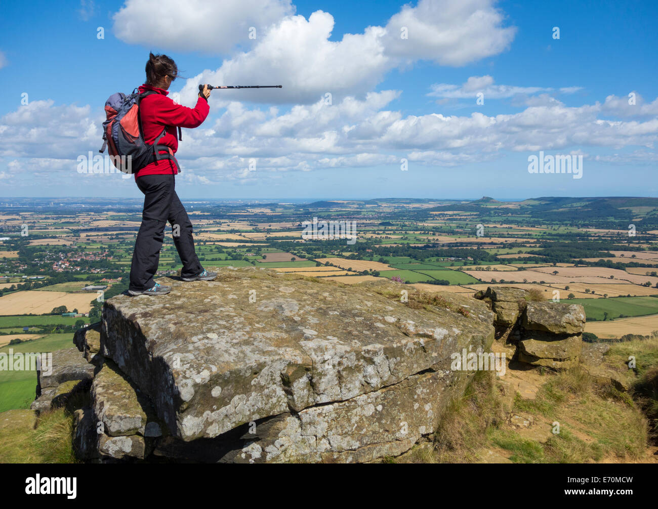 Female walker on The Wainstones at Hasty Bank on The Cleveland Way National Trail, North York Moors National Park, - Stock Image