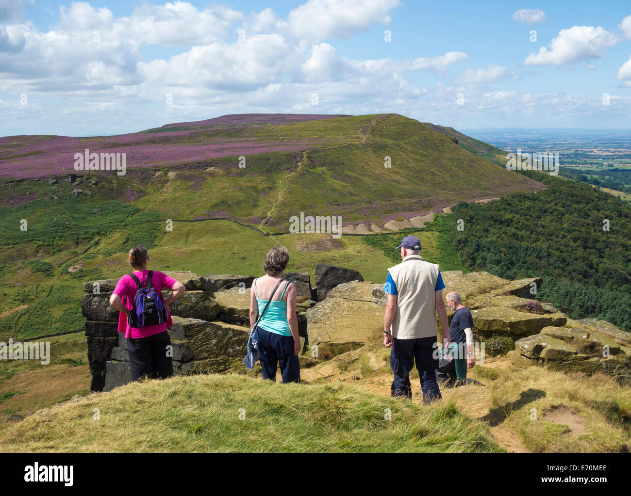 Group of mature walkers at The Wainstones at Hasty Bank on the Cleveland Hills. North York Moors National Park, - Stock Image