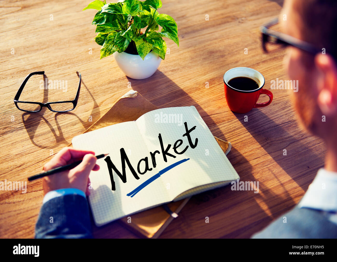 Man with a Notepad with Text Market - Stock Image
