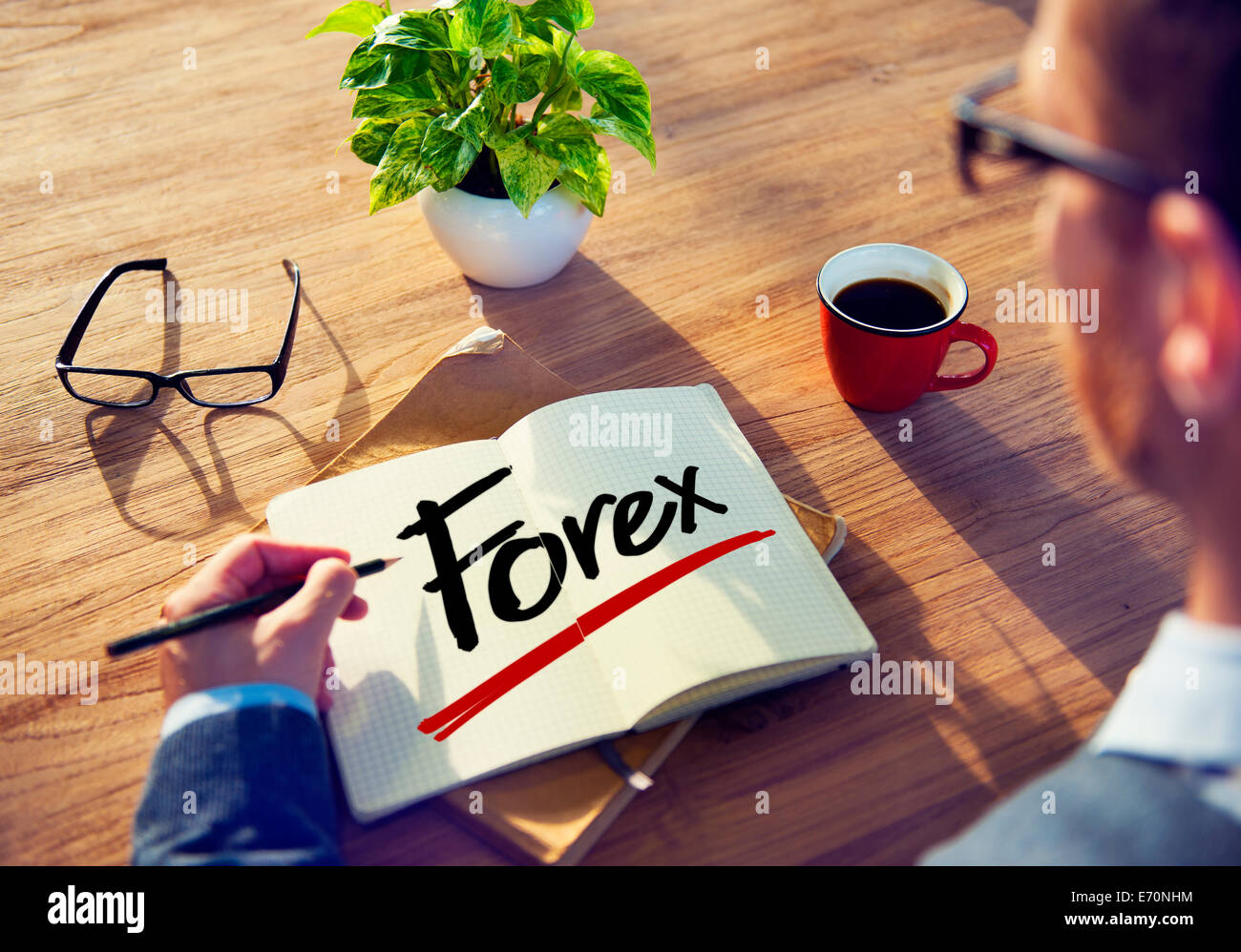 Man with Note Pad and Forex Concept - Stock Image