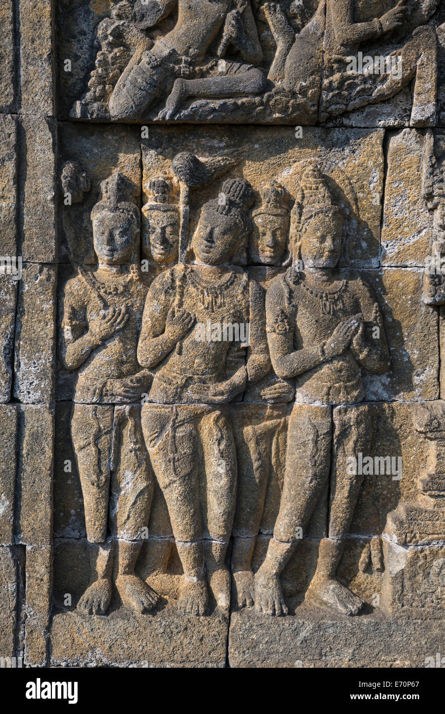 Borobudur, Java, Indonesia.  Bas-relief Carving Showing Servants, along the Walkways of the Temple. - Stock Image