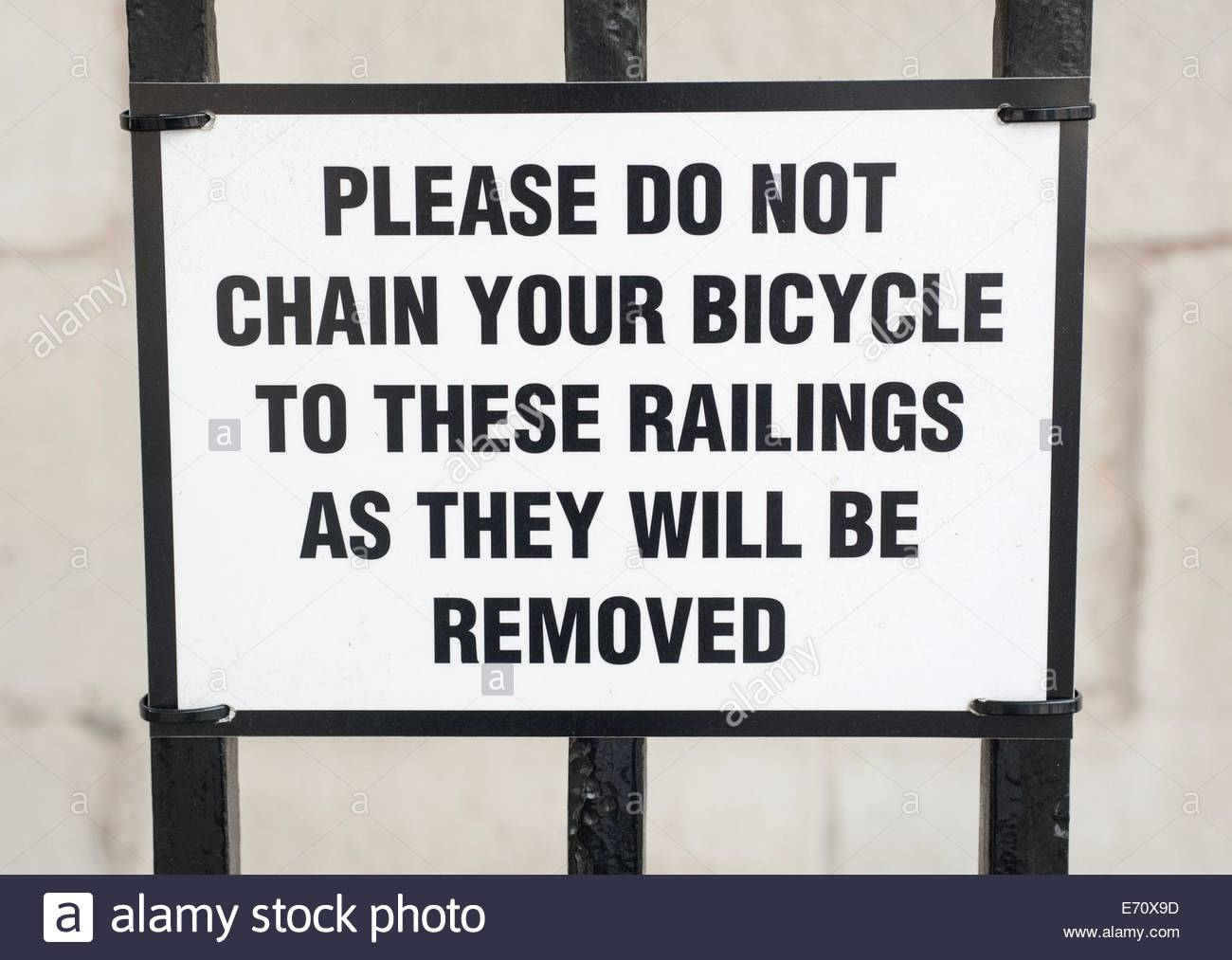London UK Warning sign not to chain bike to railings on a building in Whitehall - Stock Image