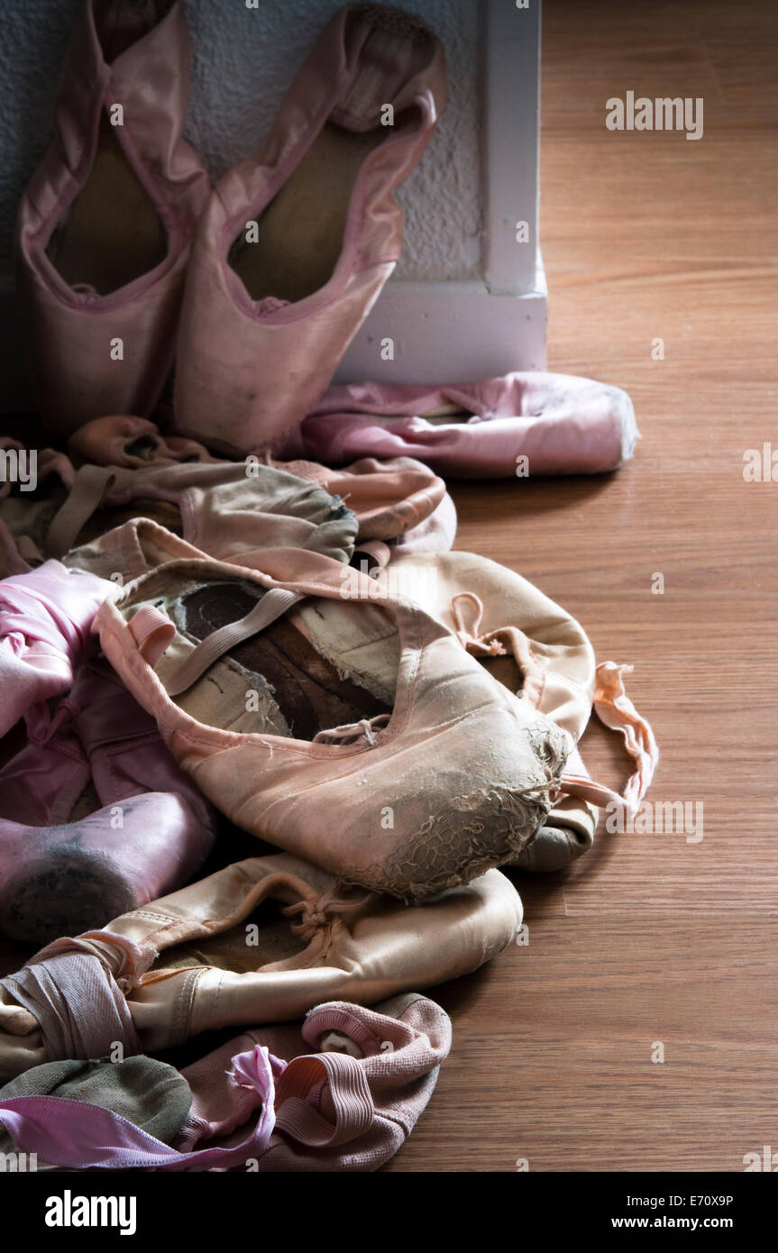 Group of pointe shoes on wooden floor - Stock Image