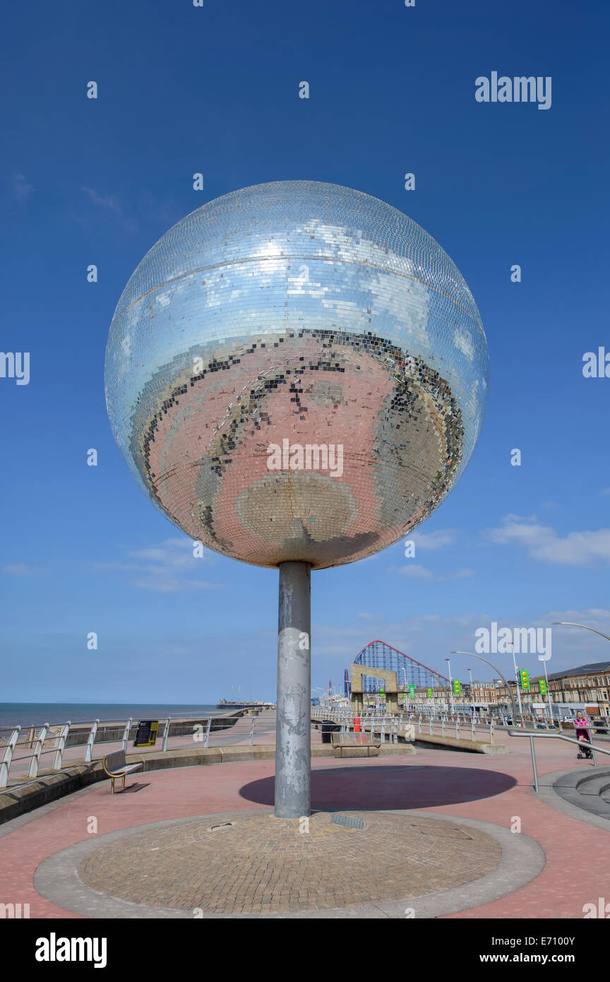 The rotating giant mirror ball on the South Shore promenade in Blackpool, Lancashire, UK - Stock Image