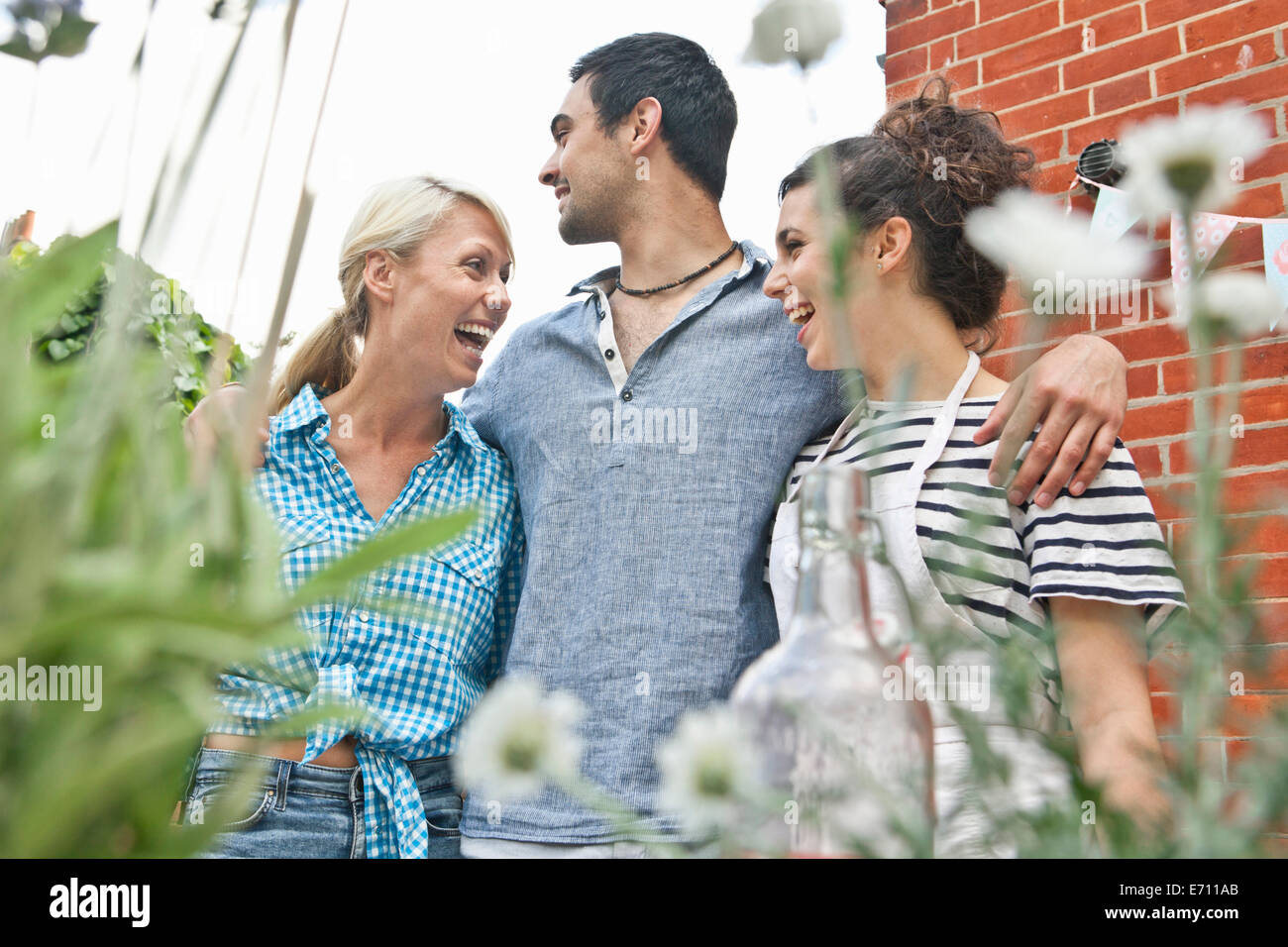 Three friends at garden party - Stock Image