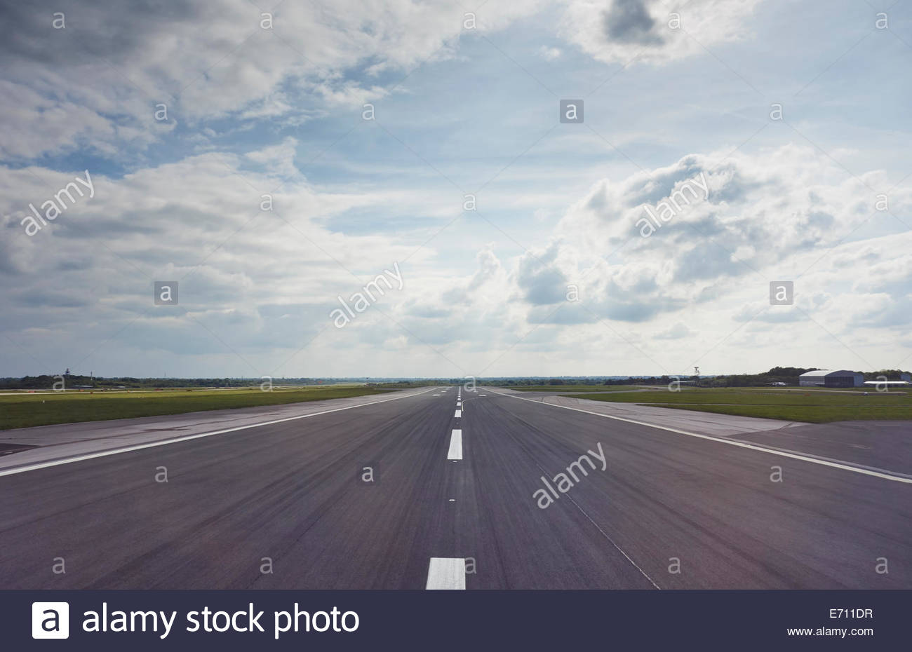 Wide angled central view of airport runway - Stock Image