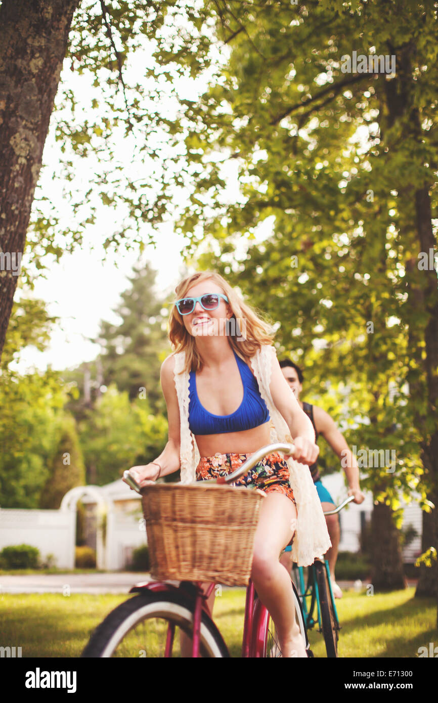 Young woman riding bike - Stock Image