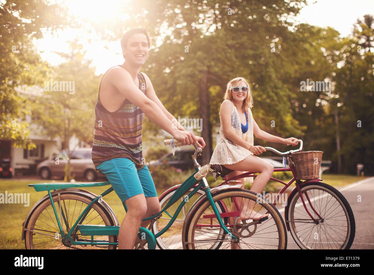 Young couple on bikes - Stock Image