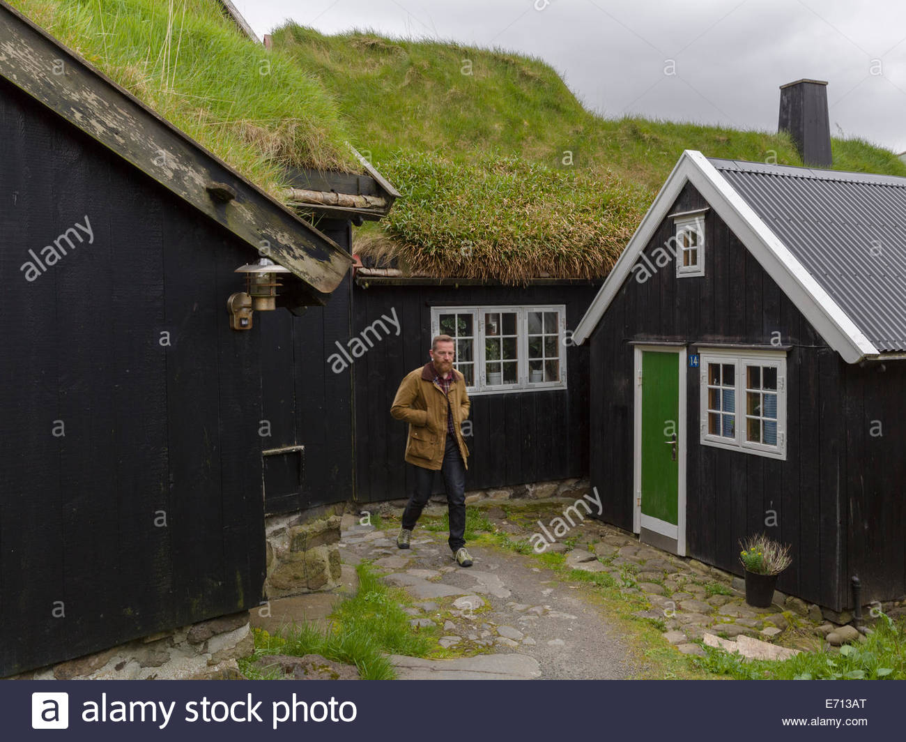 Man outside house, Torshavn, Faroe Islands, Denmark - Stock Image