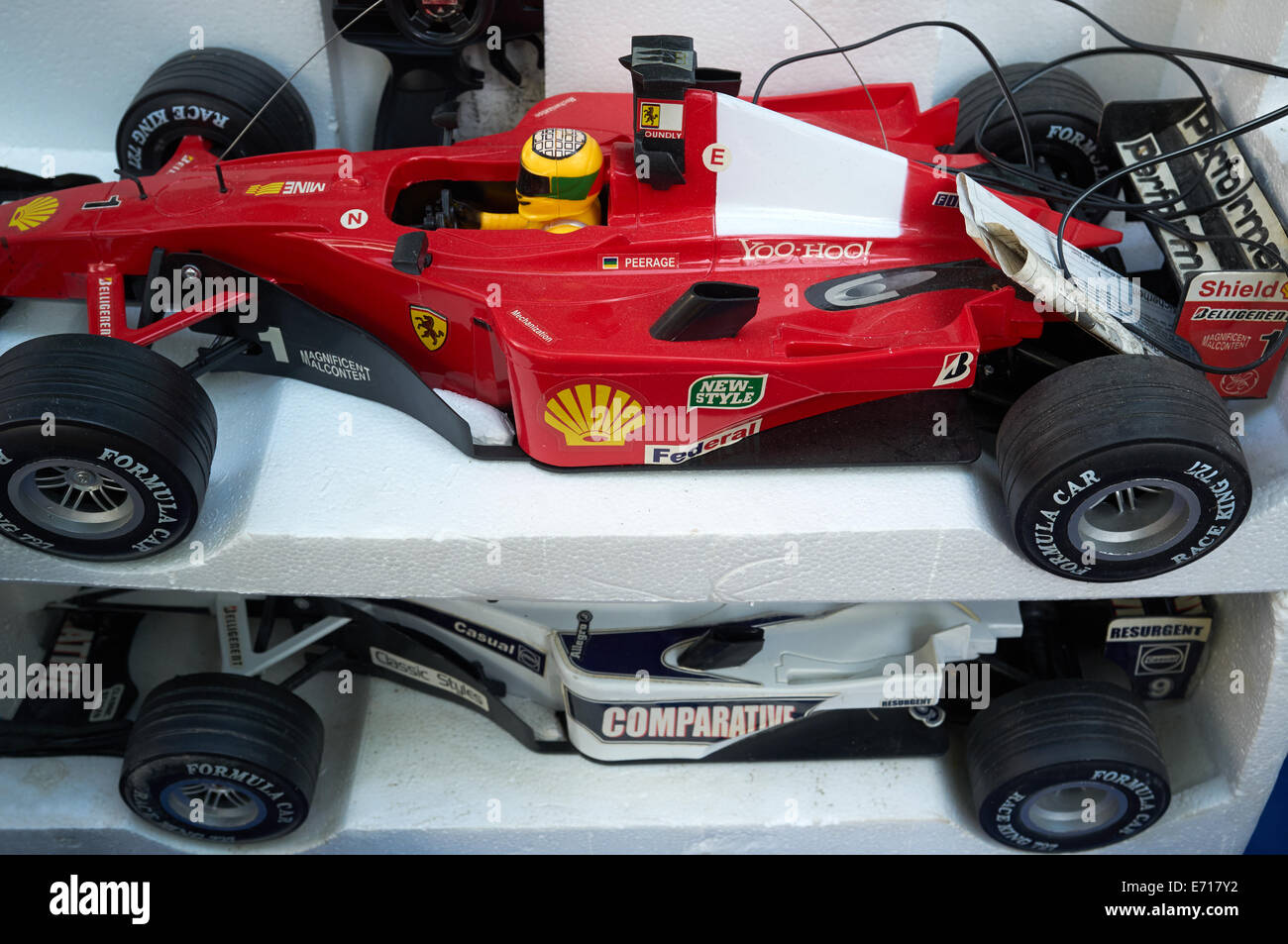 Secondhand radio controlled F1 model cars at a flea market - Stock Image