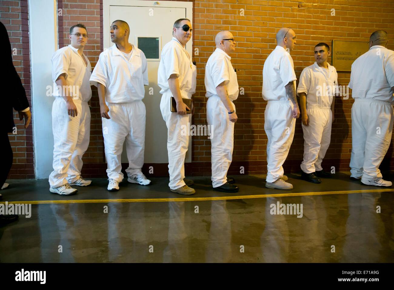 Male inmates line-up in hallways of Darrington Correctional Stock