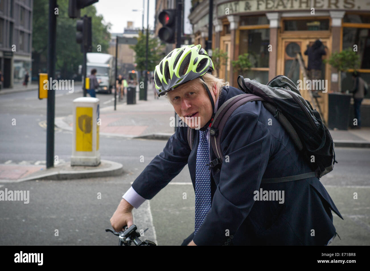 London, UK. 3rd September, 2014. Mayor of London, Boris Johnson on his way to work on his bicycle. Goswell Road, Stock Photo