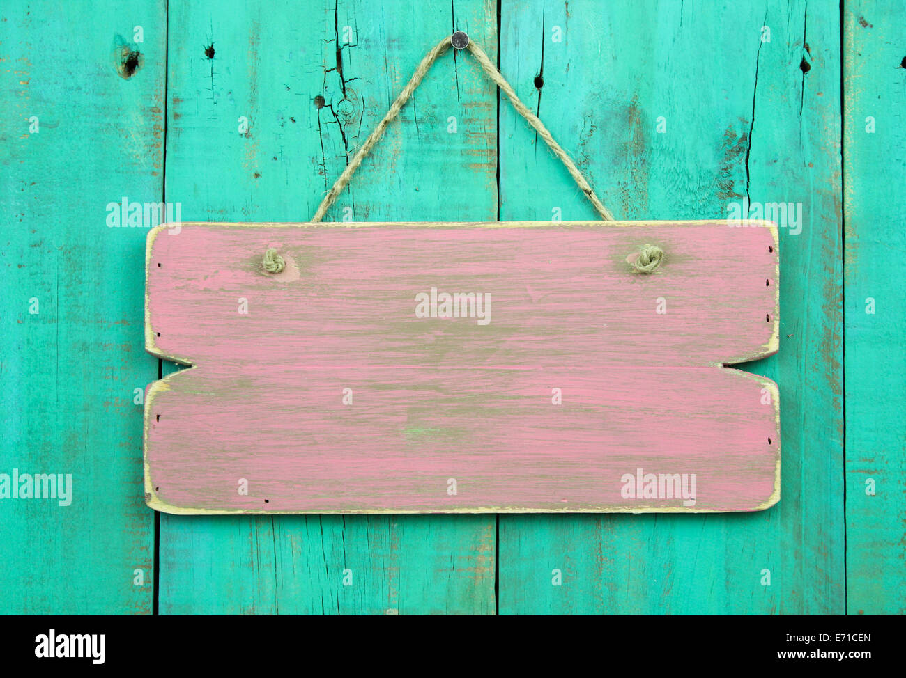 Distressed Pink Blank Sign Hanging On Antique Green Old