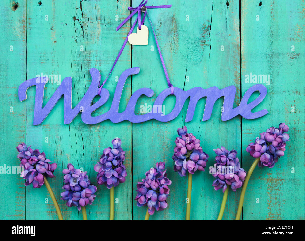 Purple Welcome Sign With Wood Heart And Spring Flowers