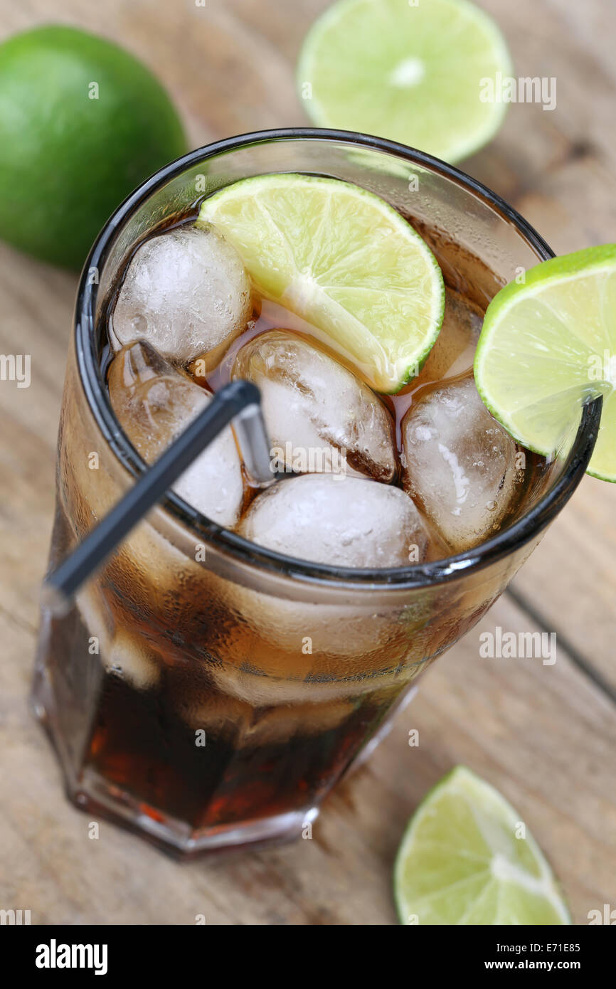 Cold cola soda lemonade drink with ice cubes - Stock Image
