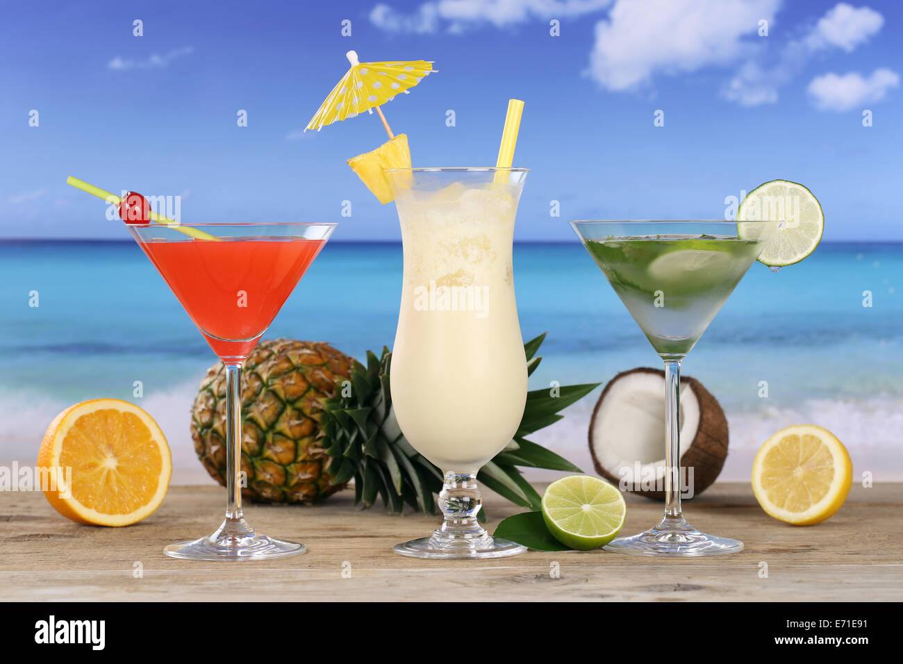 Cocktails and drinks like Pina Colada and Martini on the beach and sea - Stock Image