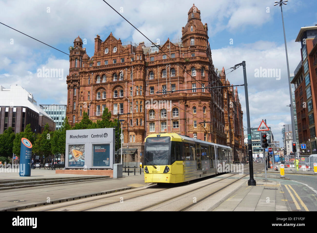 Metrolink tram with Midland hotel in the background in central Manchester. - Stock Image