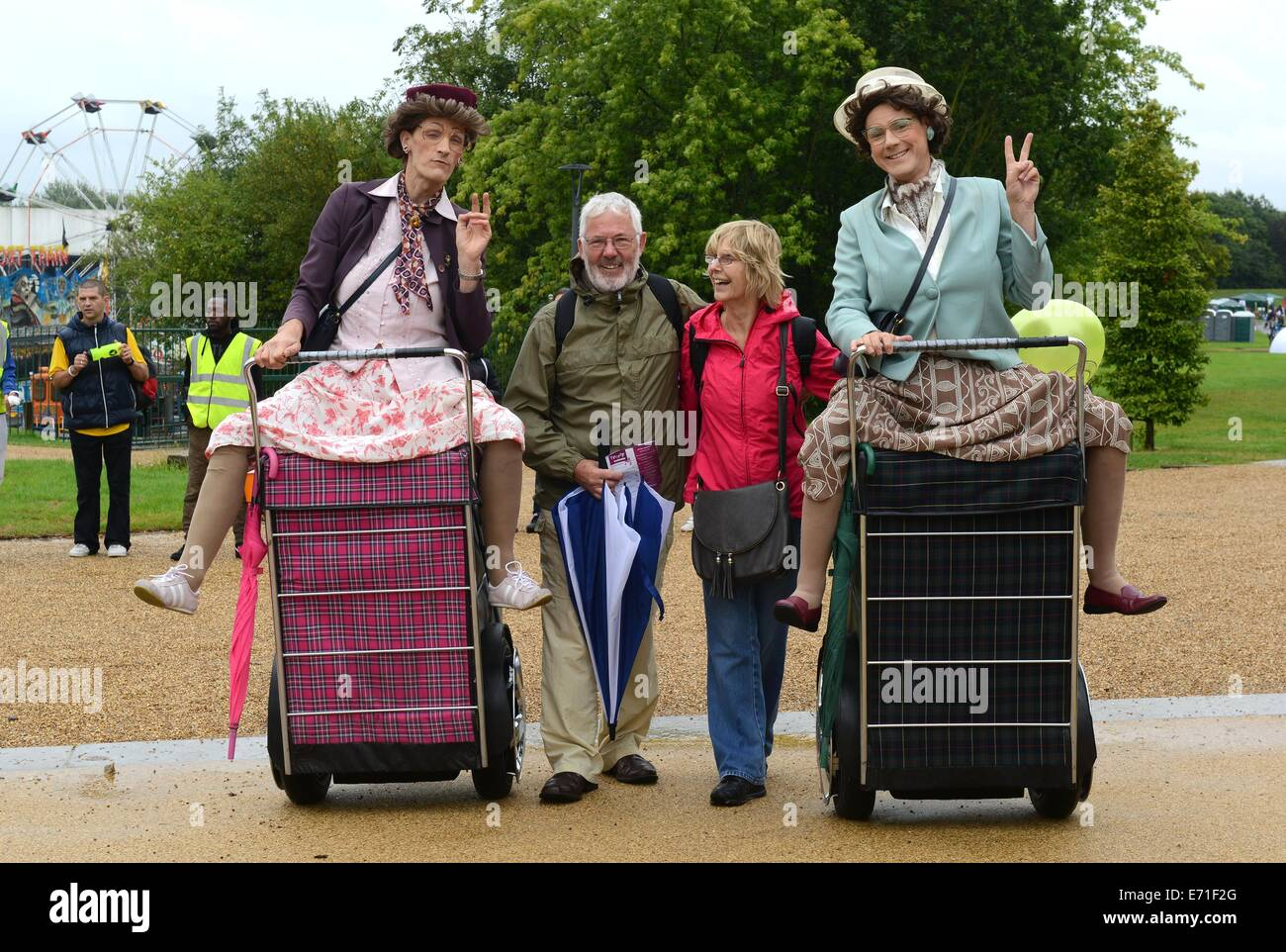 Entertainers Granny Turismo having fun with Richard and Sue Pearson at Telford Town Park. - Stock Image