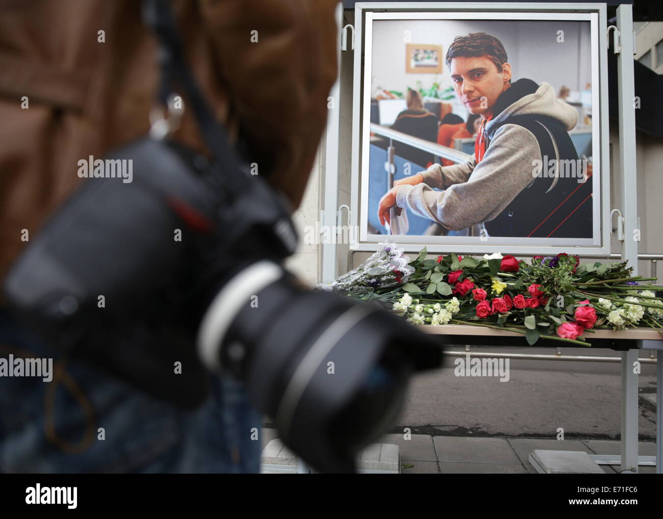 Moscow, Russia. 3rd Sep, 2014. A portrait of Rossiya Segodnya photo journalist Andrei Stenin outside the news agency's - Stock Image