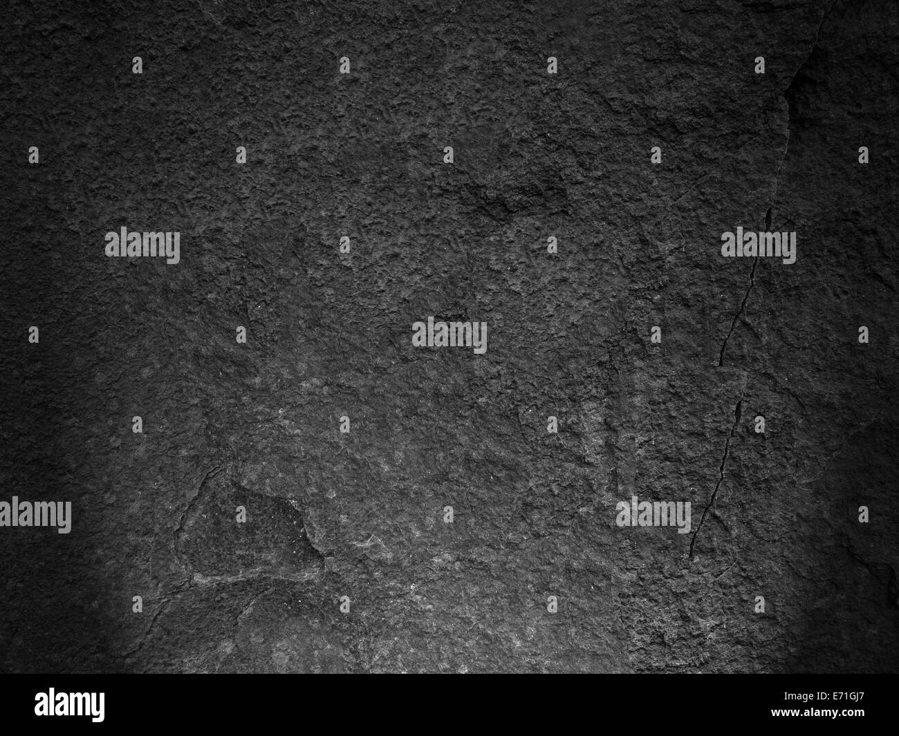 Detail of black rock texture and roughness - Stock Image