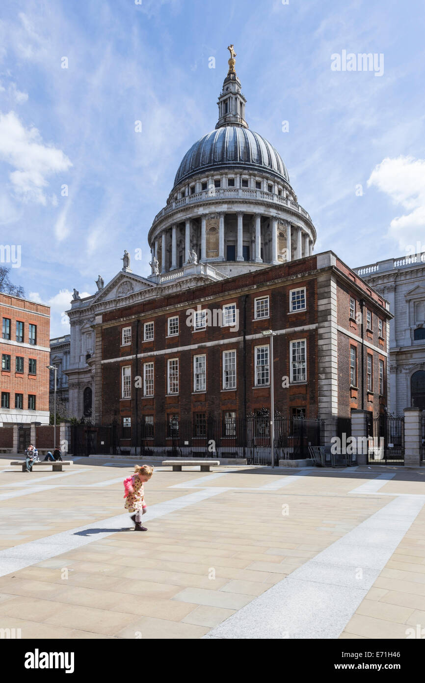 Young girl playing in Paternoster Square with St Paul's Cathedral in the background, City of London, England, UnitedStock Photo