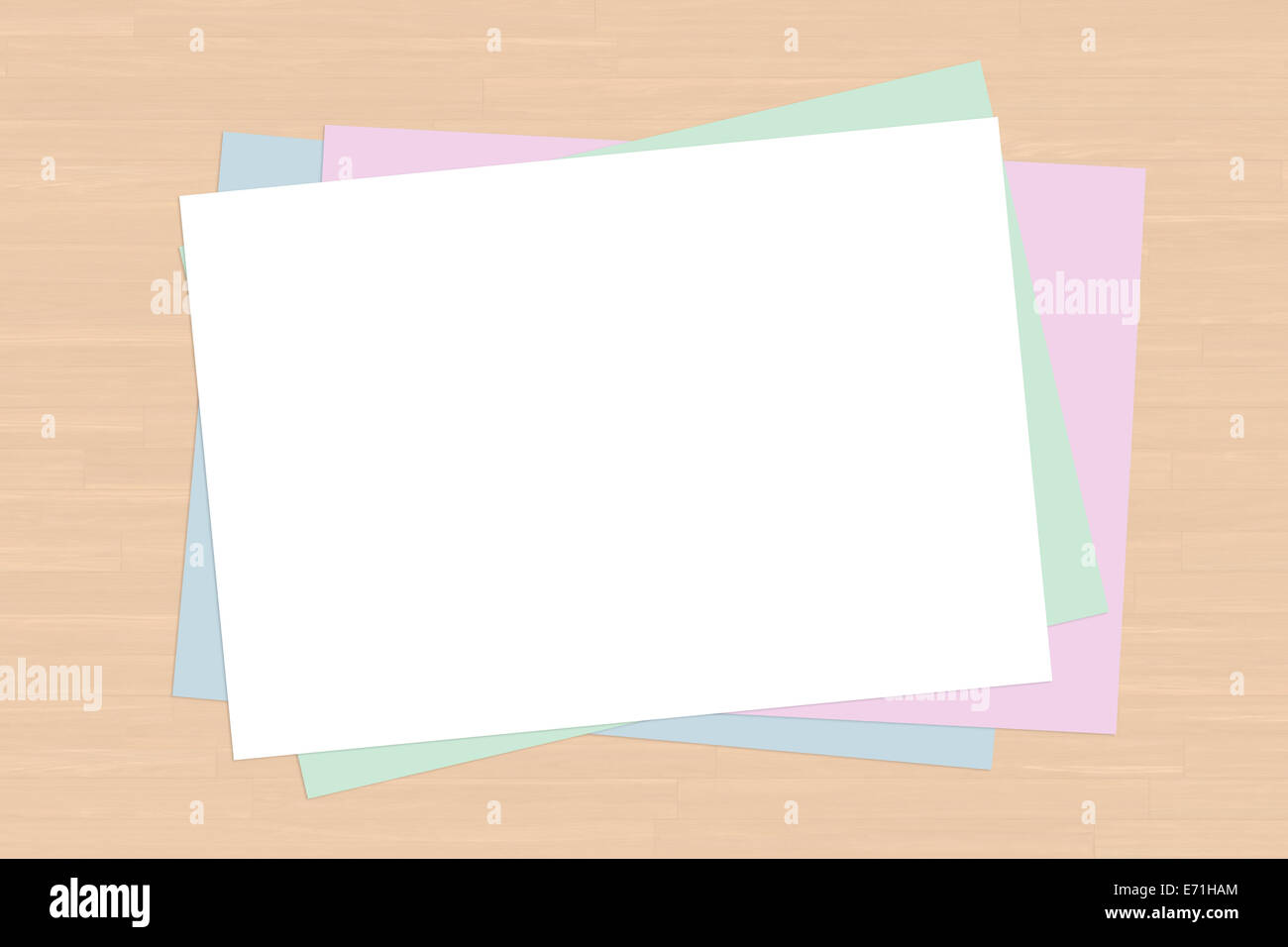 Top view of blank colorful note paper sheet on wooden table. - Stock Image