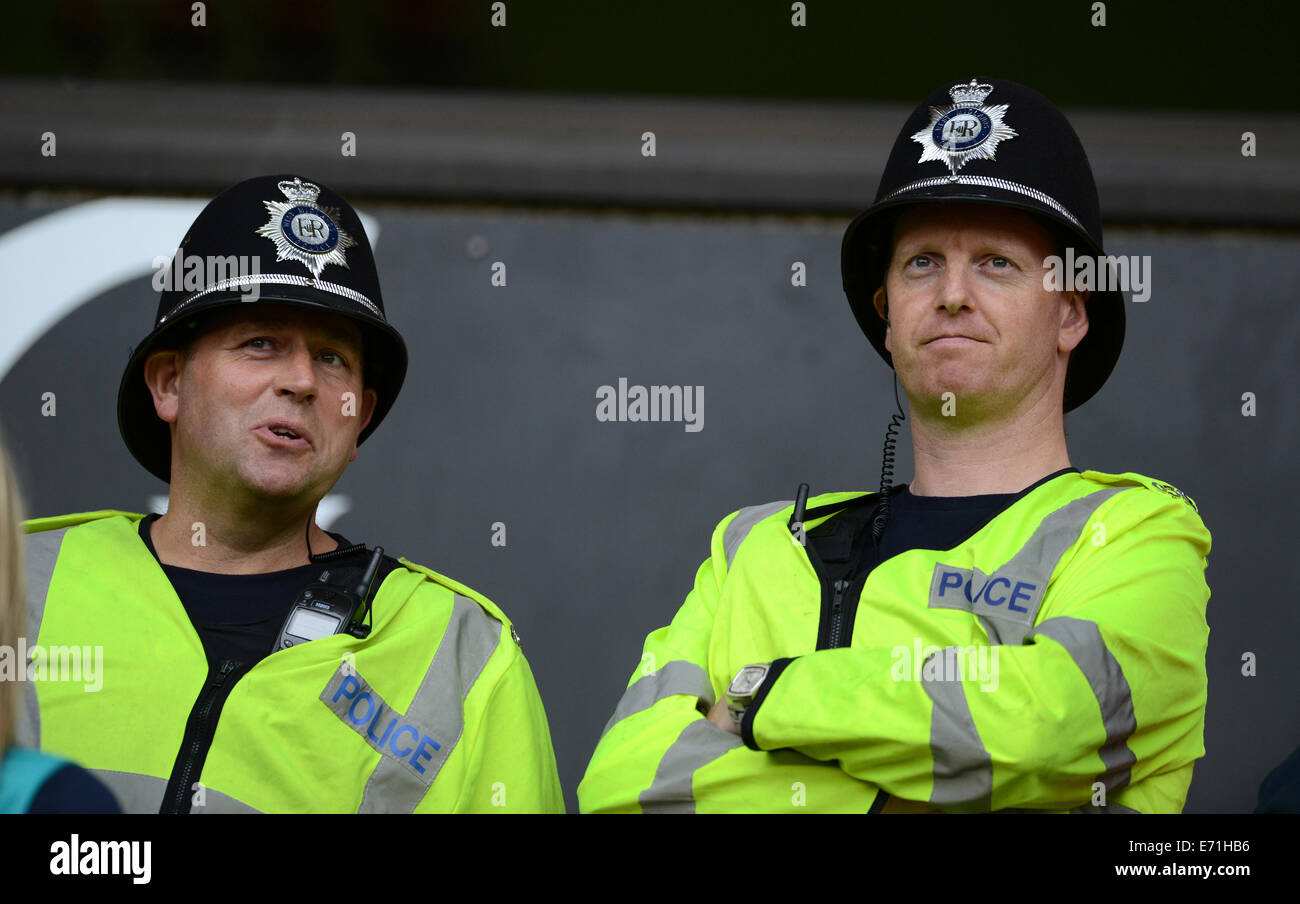 Two West Midlands police officers policemen officer policeman talking on duty - Stock Image
