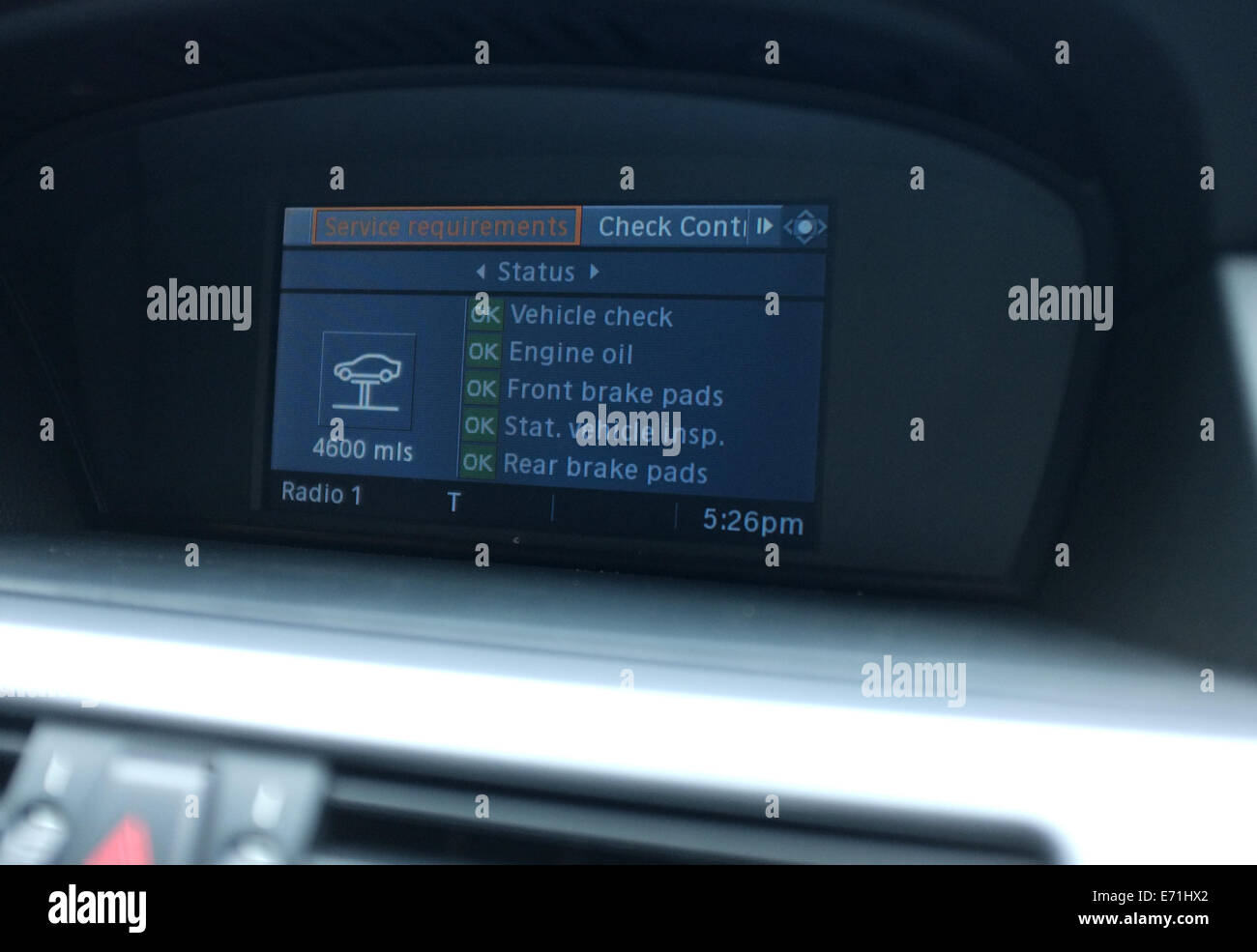 2008 BMW car iDrive information screen showing vehicle service Stock