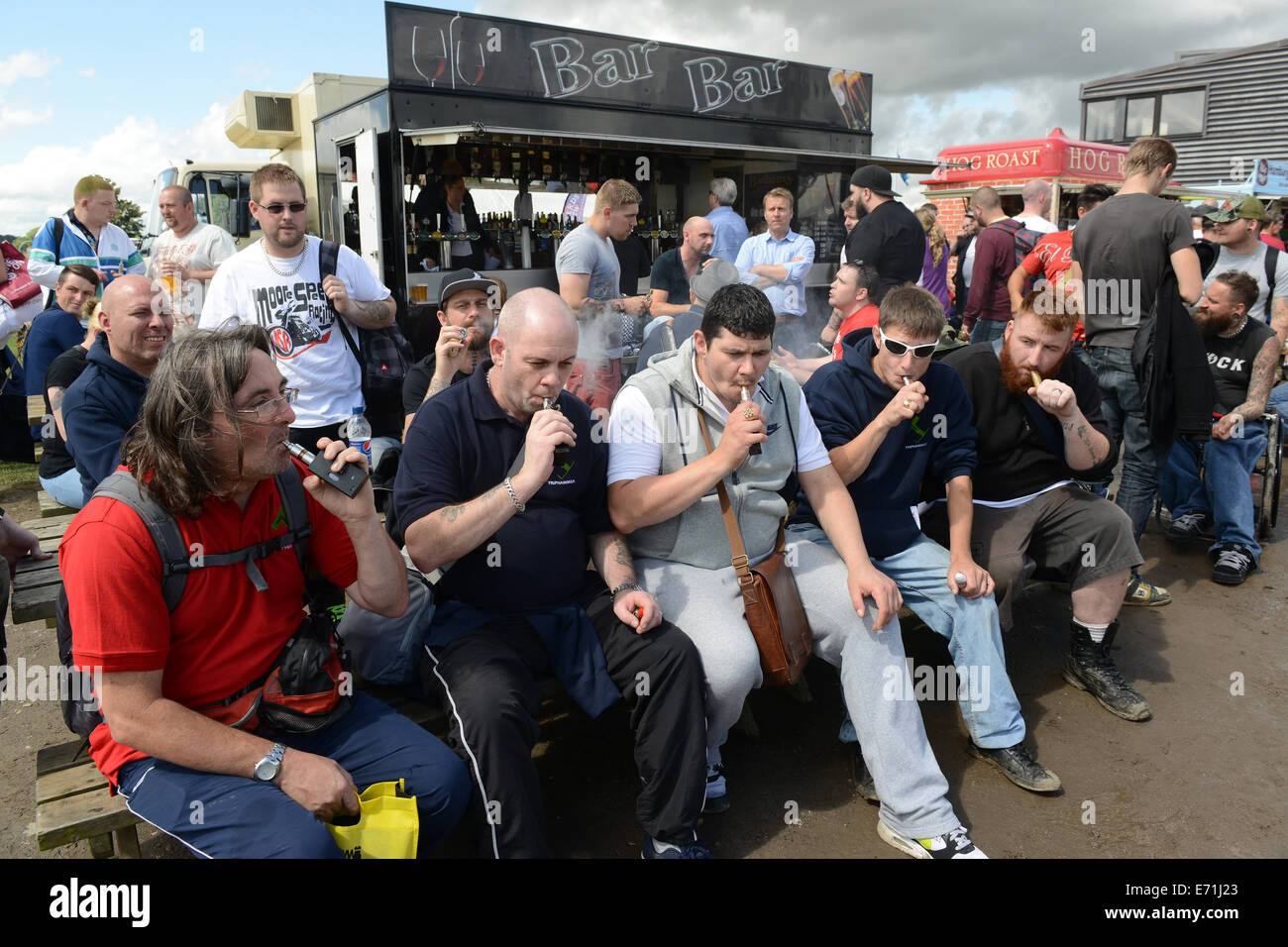 Vapour enthusiasts inhaling from their e cigarettes as thousands of vapoursists attend the 2nd annual Vapour Festival - Stock Image