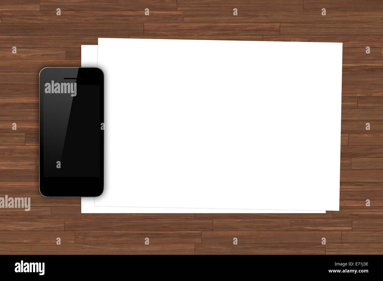 Smart phone with blank black screen and white blank sheet on wooden table. - Stock Image