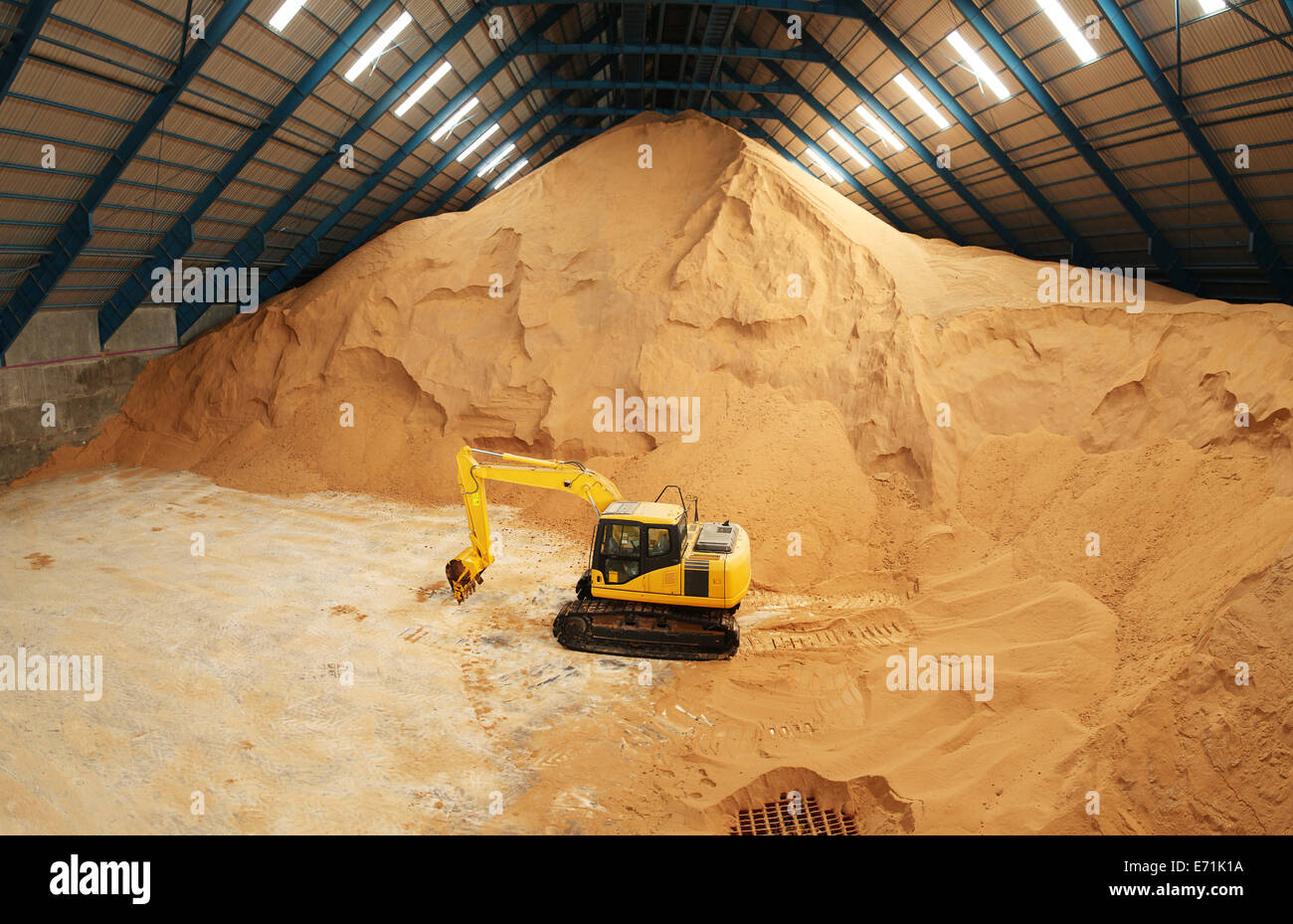 Ordinaire Excavator In A Raw Sugar Factory Storage Building