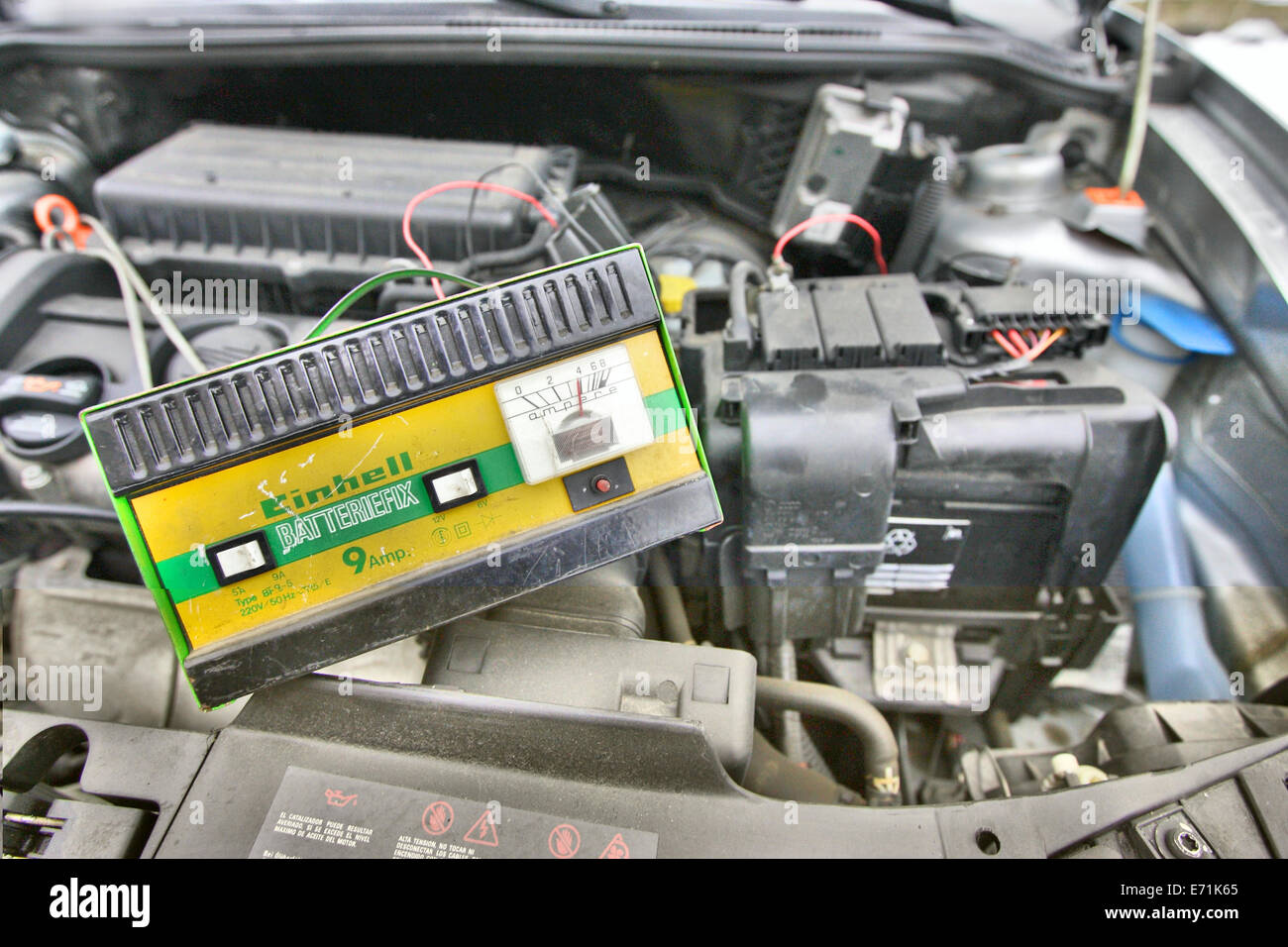Charging car battery by the rectifier in the silver Seat Cordoba - Stock Image