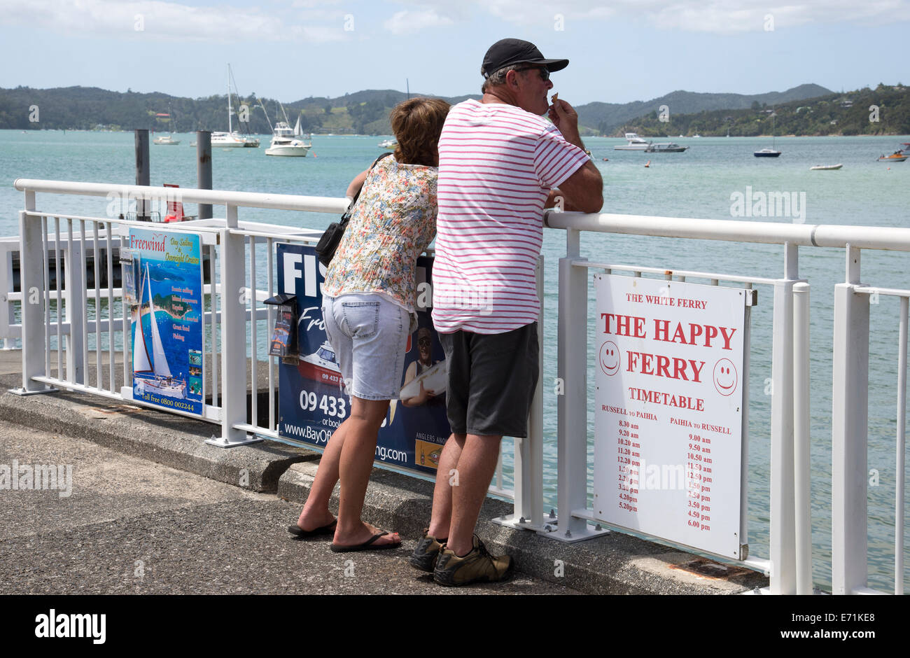 Tourists on the pier at Paihia North island New Zealand Stock Photo