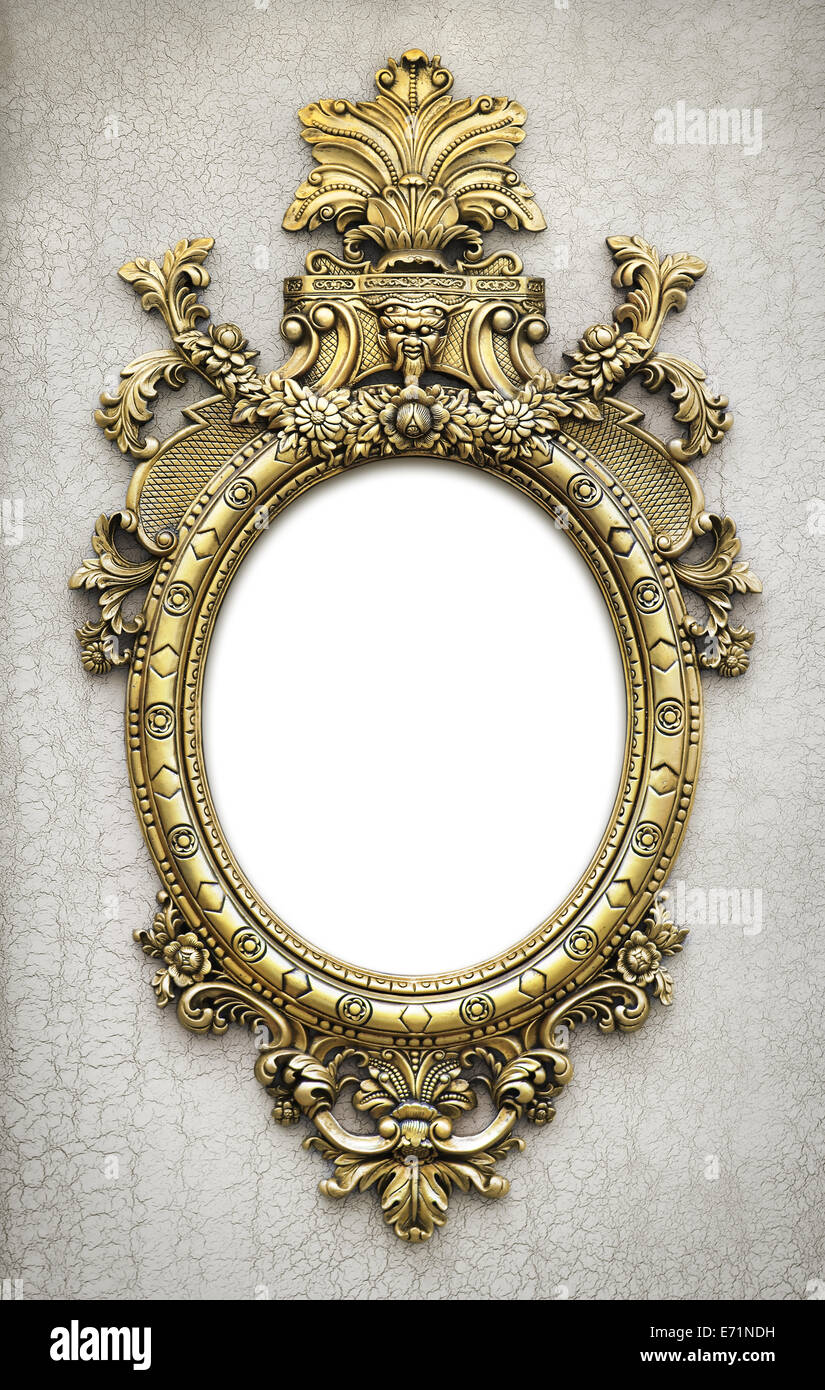 beautiful and complex golden baroque frame hanged on a textured wall ...