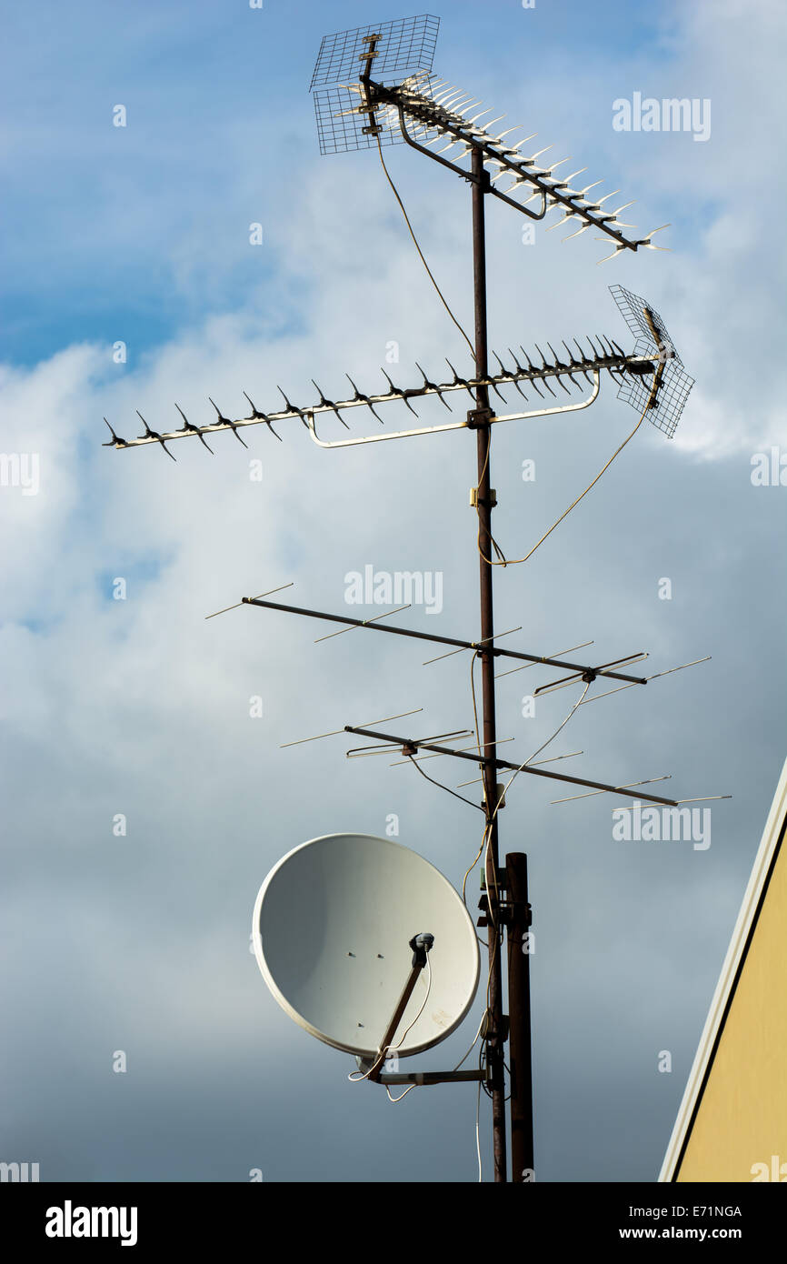 Multiple Aerials on Rooftop Stock Photo
