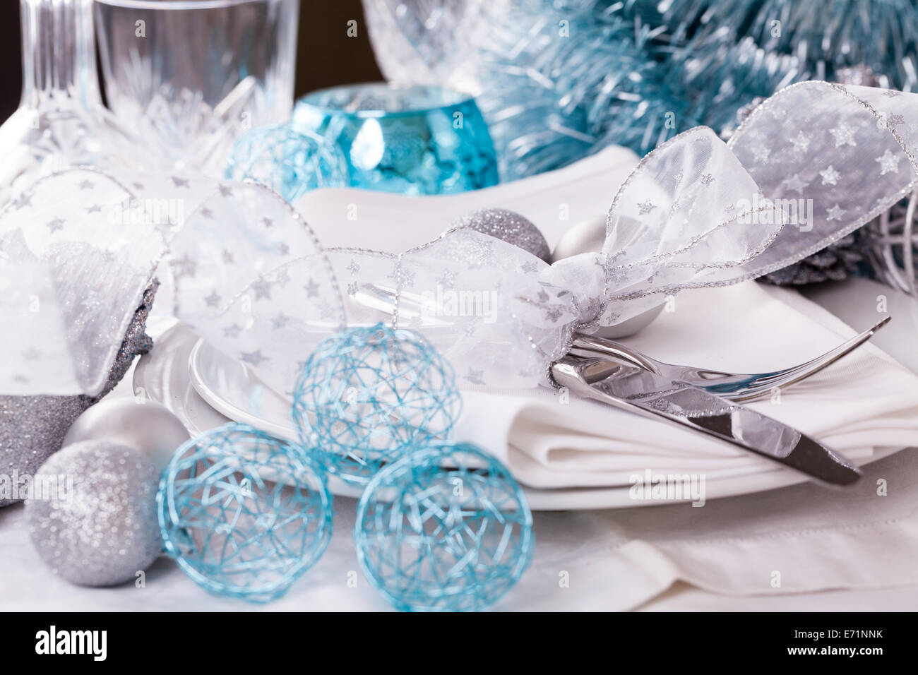 Stylish blue and silver Christmas table setting with a pretty translucent bow on white dinnerware with & Stylish Blue Silver Christmas Table Stock Photos u0026 Stylish Blue ...