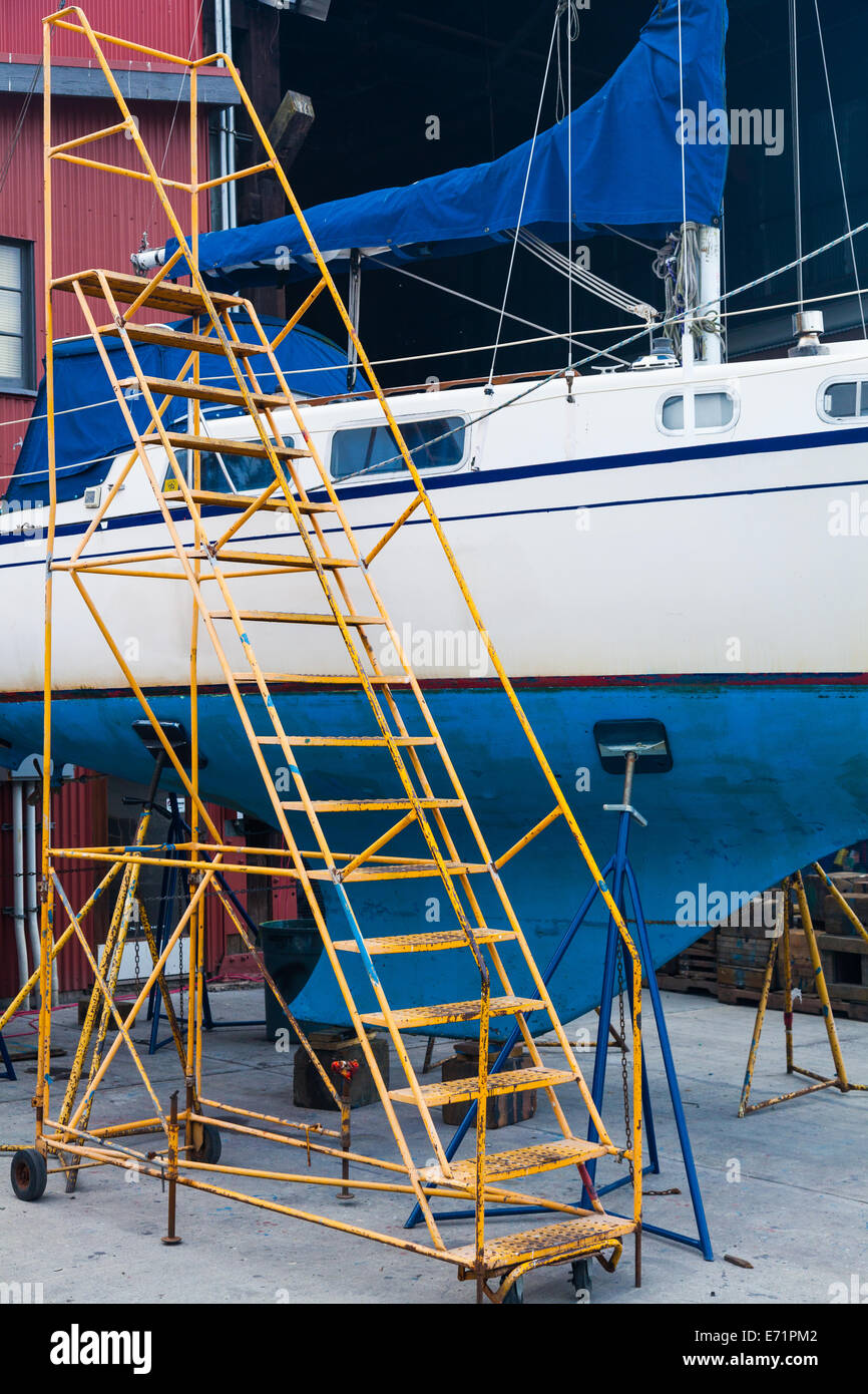 Sailing vessel supported for maintenance on land, Granville Island, Vancouver. - Stock Image