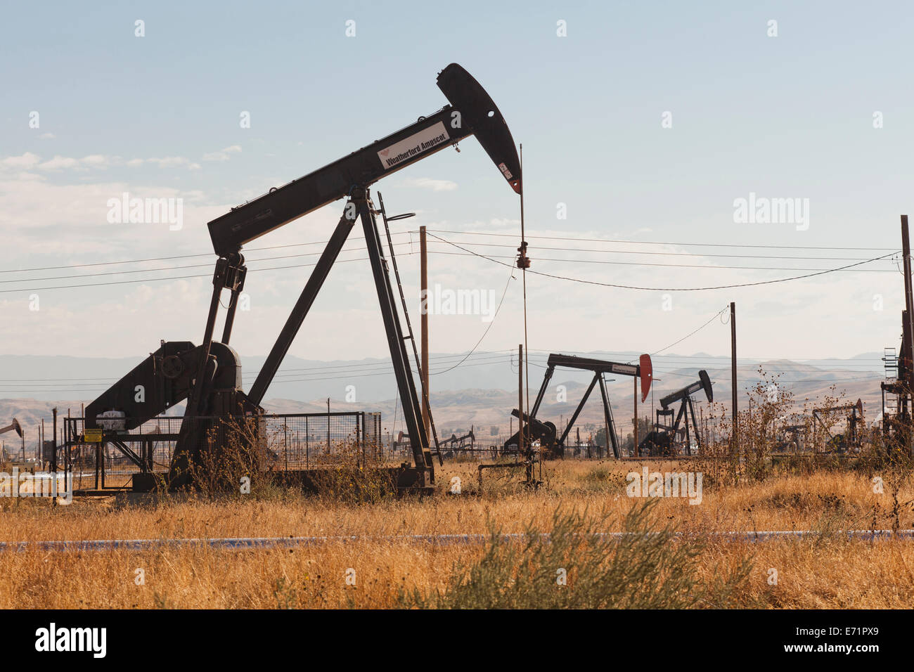 Oil pumpjacks - Kern River Oil Field, Coalinga, California USA - Stock Image