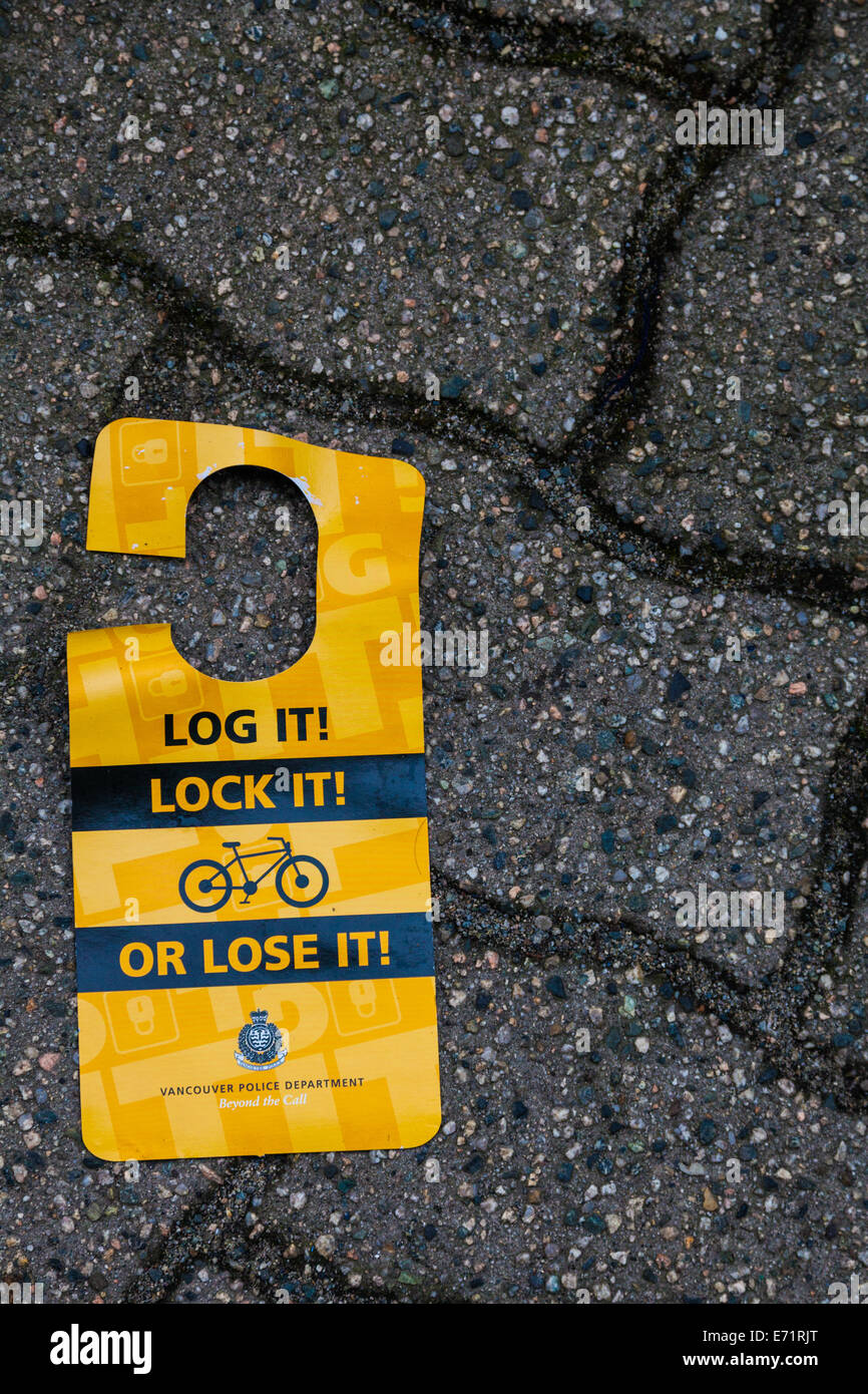 Discarded sign warning of bike theft and possible precautions, Vancouver, Canada - Stock Image
