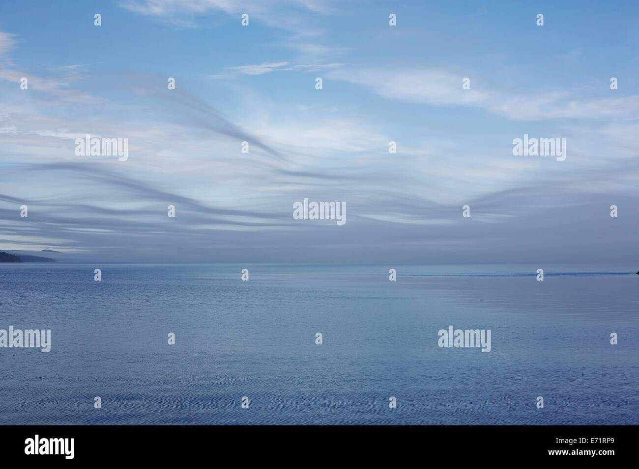 The blue sky and blue water of Lake Superior meet seamlessly. Stock Photo