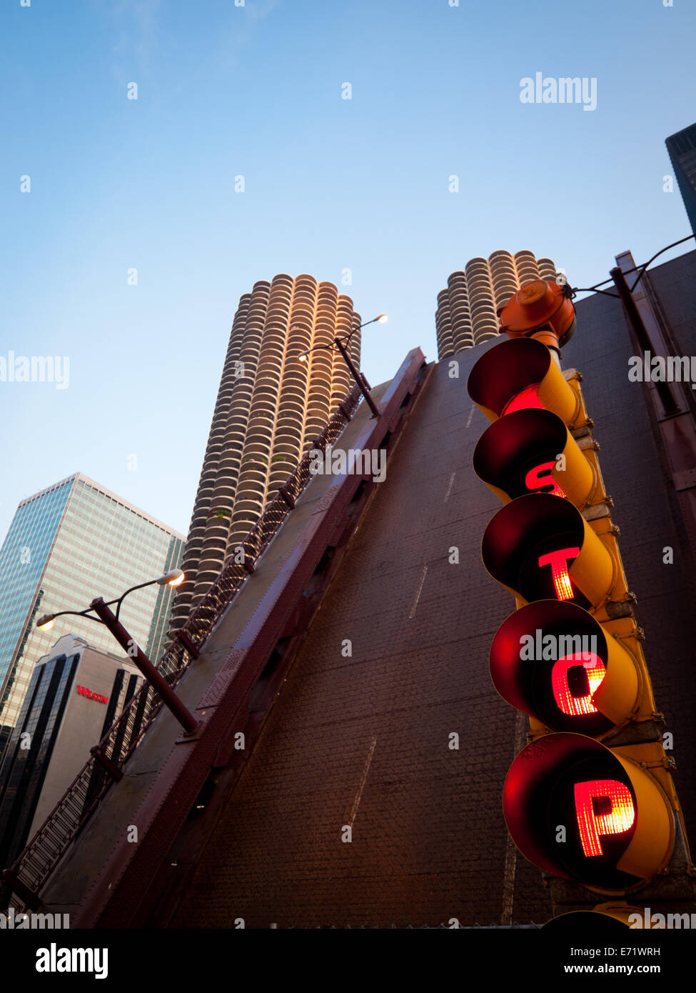 A view of a red stoplight in front of the raised State Street Drawbridge in Chicago, Illinois. - Stock Image
