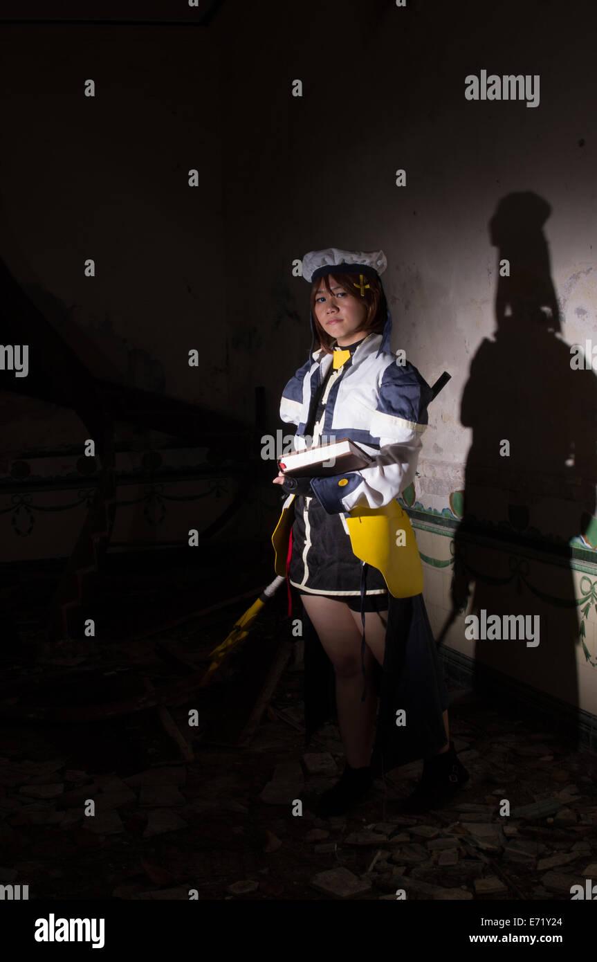 a cosplayer cosplaying as hayate yagami from Magical Girl Lyrical Nanoha Stock Photo