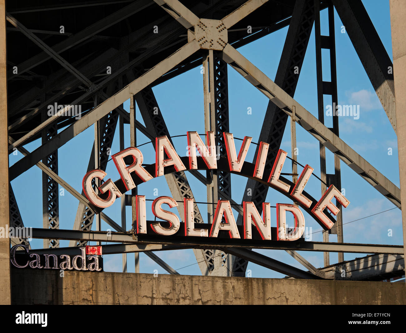 A low angle view of the neon 'Granville Island' sign at the entrance to the market, Vancouver, Canada - Stock Image