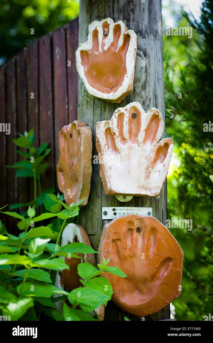 Terracotta hand prints of volunteer garden helpers in an educational project in UK - Stock Image