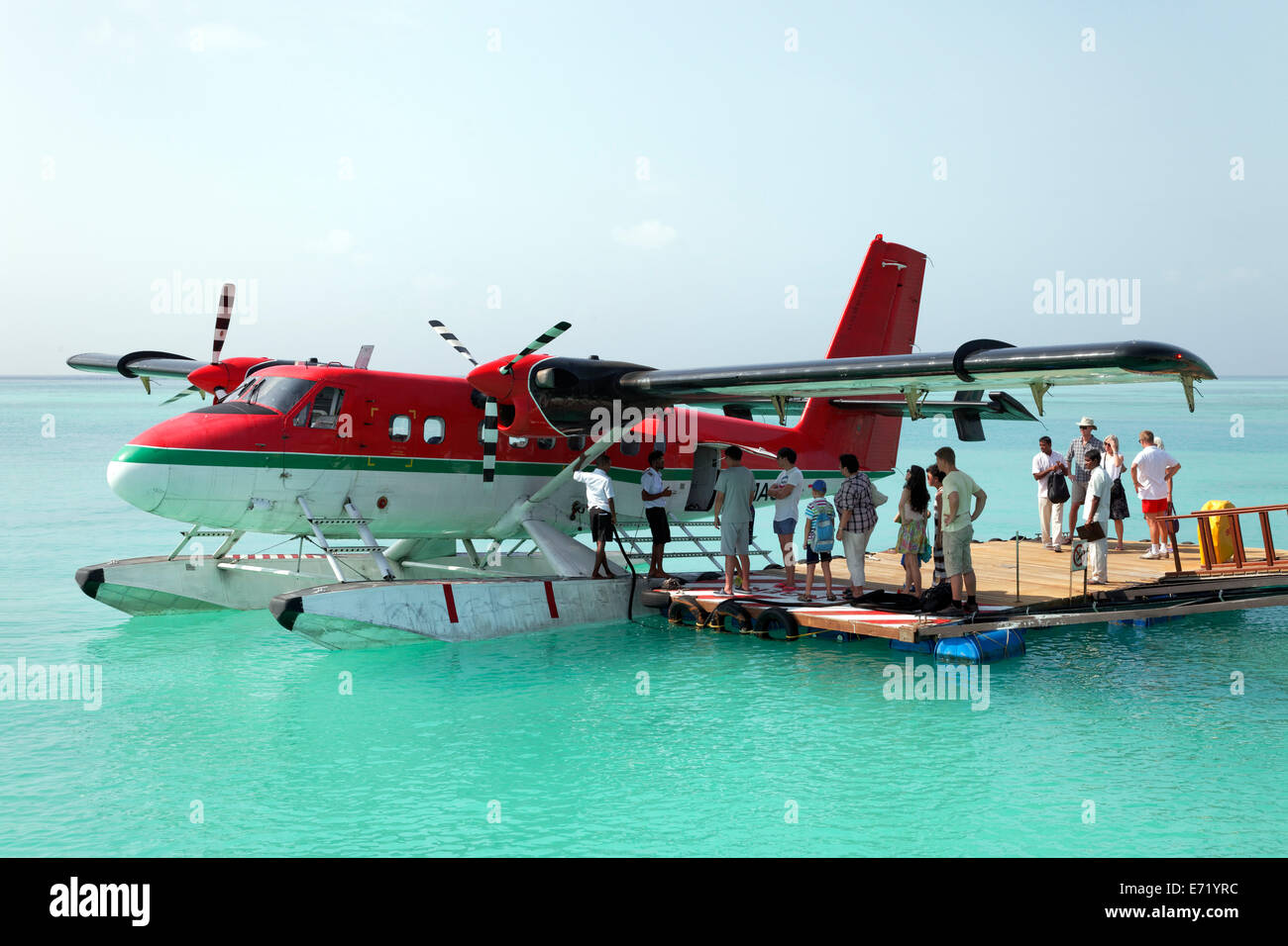 Passengers boarding a De Havilland Canada DHC-6 Twin Otter hydroplane, floating pontoon, Maldives - Stock Image
