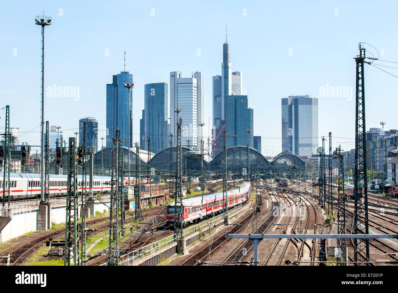 Railway tracks, sidings, of Deutsche Bahn AG at Frankfurt main station, at the back the Frankfurt skyline with the - Stock Image