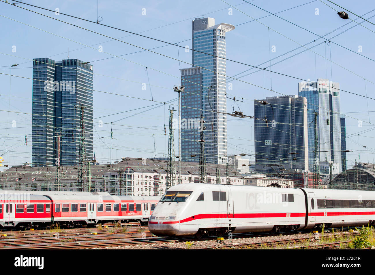 ICE train on the tracks of Deutsche Bahn AG at Frankfurt main station, at the back the skyline of Frankfurt with - Stock Image