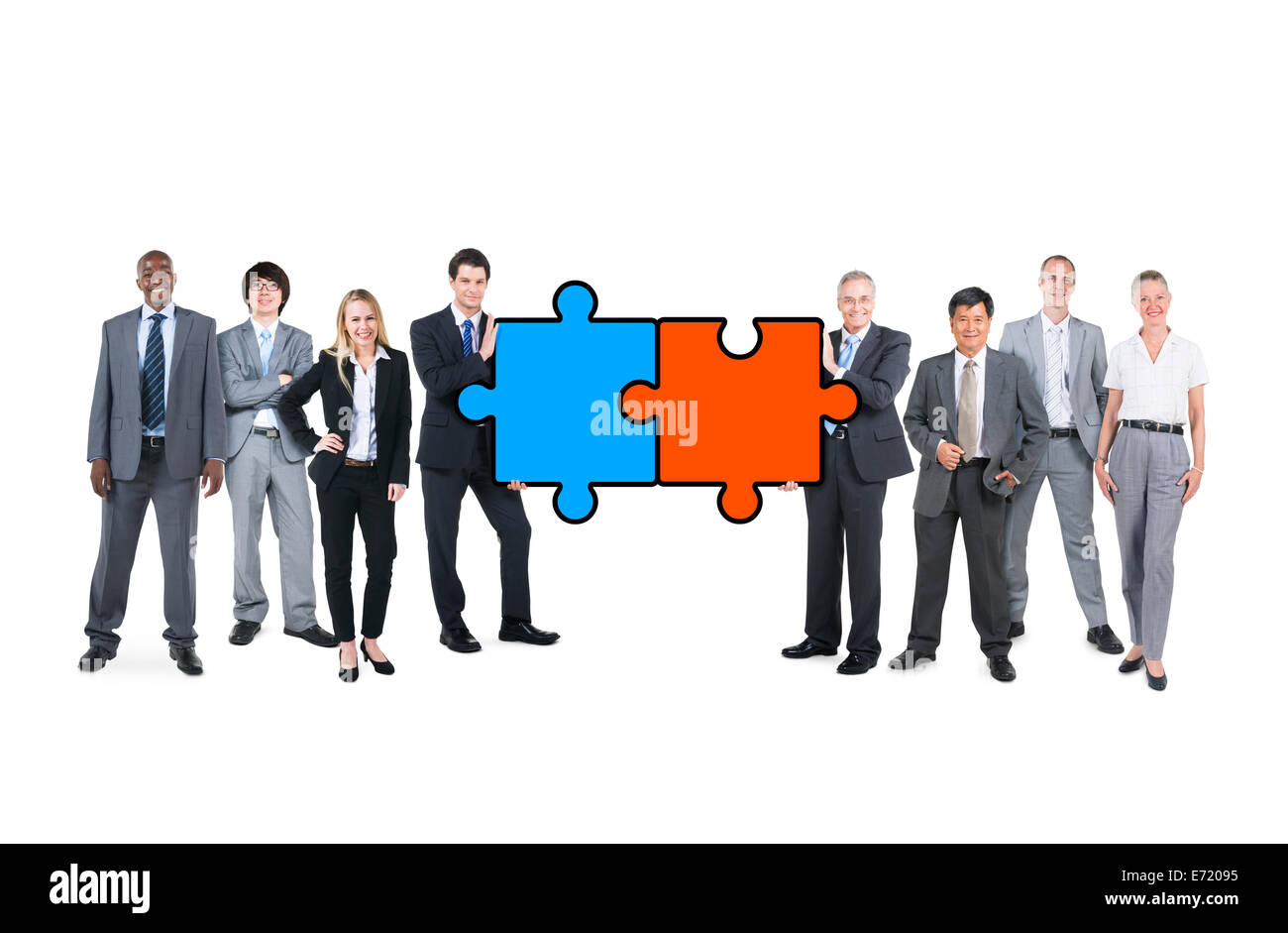 Group of Multiethnic Business People Connecting Jigsaw Puzzle - Stock Image