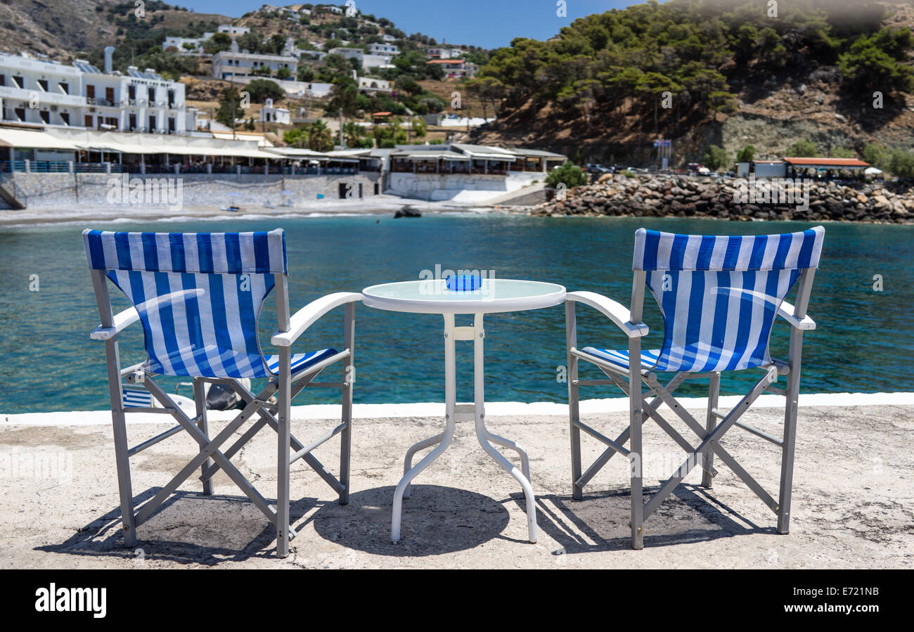 Two Blue And White Stripe Directors Chairs On The Quay Wall In Hora Sfakion  Sfakia Crete