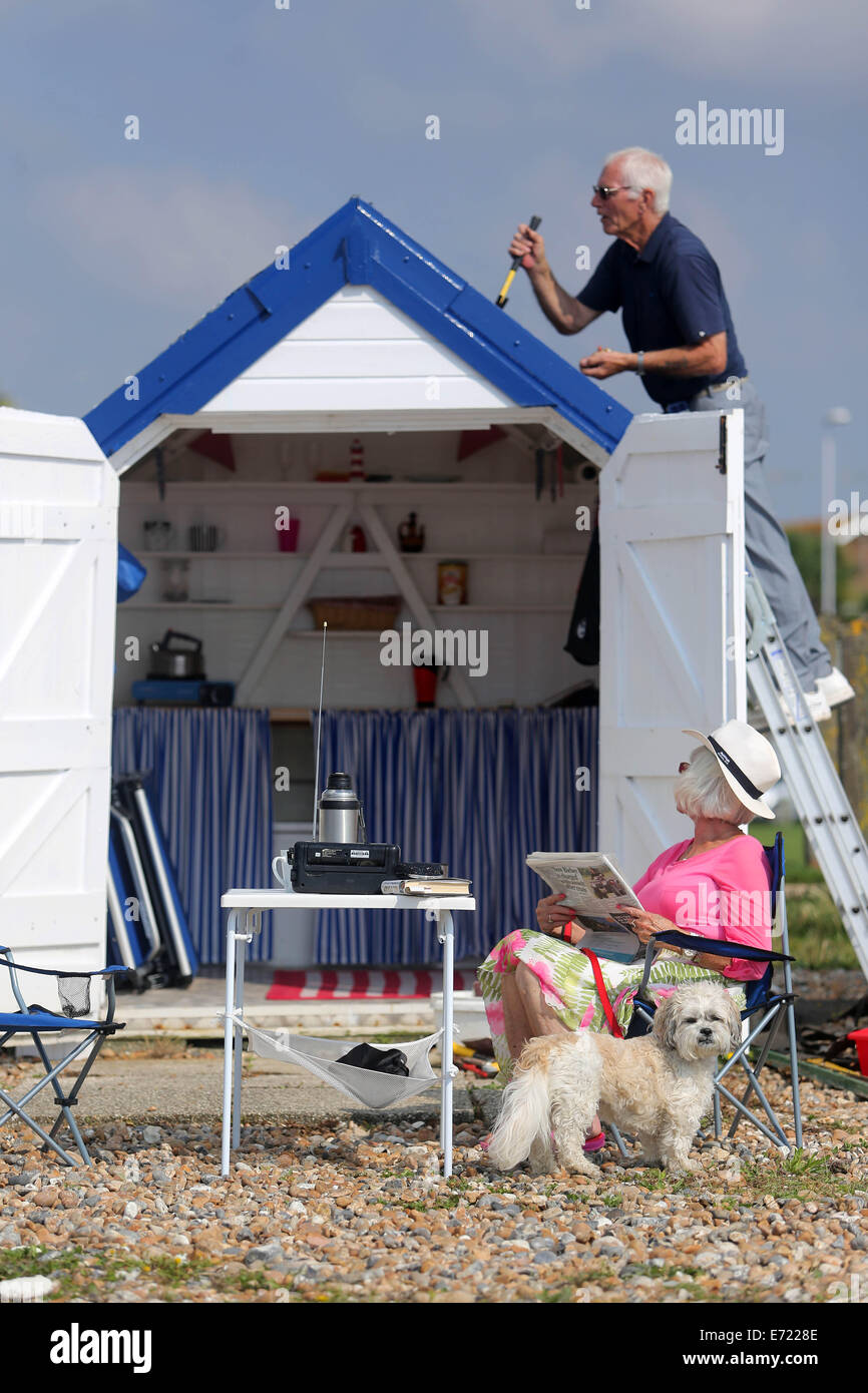 03/09/2014 - Picture by Ciaran McCrickard Photography - A retired couple enjoy their beach hut on Worthing seafront, - Stock Image